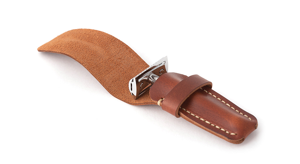 safety razor in leather sleeve